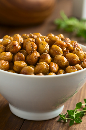 garbanzo bean: Chickpeas roasted with thyme, oregano, salt and pepper, photographed with natural light (Selective Focus, Focus in the middle of the image)