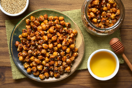 garbanzo bean: Chickpeas roasted with sesame and honey, photographed overhead on wood with natural light