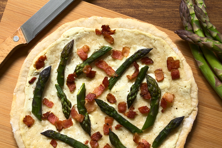alsatian: Green asparagus and bacon tarte flambee or Flammkuchen, a typical Alsatian and South German dish, photographed overhead with natural light
