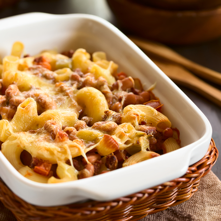 quadratic: Chili con carne and macaroni pasta casserole in baking dish, photographed with natural light (Selective Focus, Focus one third into the dish) Stock Photo