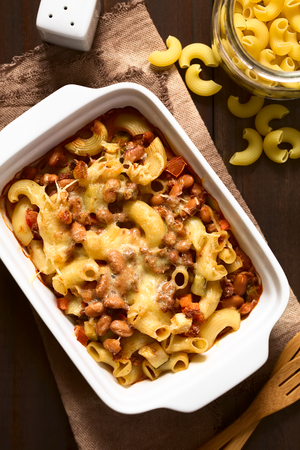 Chili con carne and macaroni pasta casserole in baking dish, photographed overhead with natural light (Selective Focus, Focus on the top of the dish)