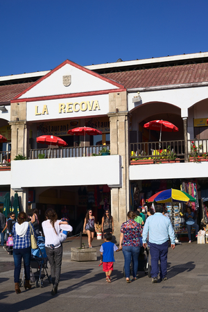 center hall colonial: LA SERENA, CHILE - FEBRUARY 27, 2015: Unidentified people walking towards La Recova municipal market in the city center on February 27, 2015 in La Serena, Chile. La Recova houses mainly artisan shops and restaurants.