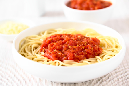 marinara sauce: Traditional Italian Spaghetti alla Marinara (spaghetti with tomato sauce) in bowl, photographed with natural light (Selective Focus, Focus in the middle of the image) Stock Photo