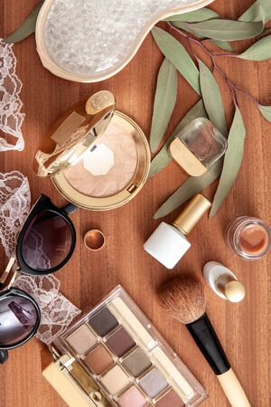 Make up flat lay on wooden background. Natural cosmetics composition