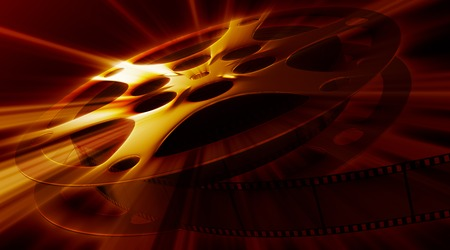 cinematographer: Shining film reel on the dark background