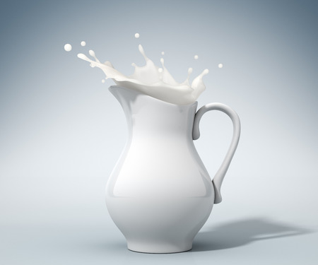 milk jug: Milk pouring from a pitcher Stock Photo