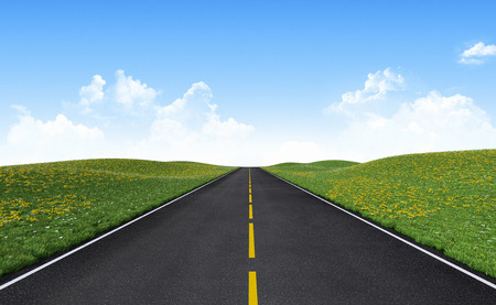 Straight asphalt road among green hills. Clipping path included.
