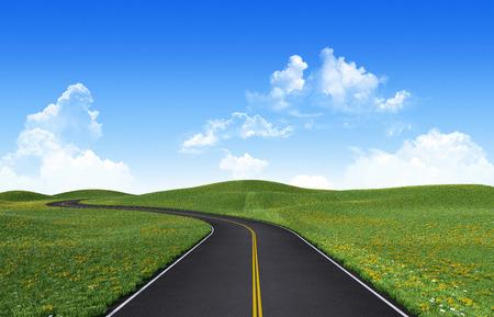 Winding road among green hills