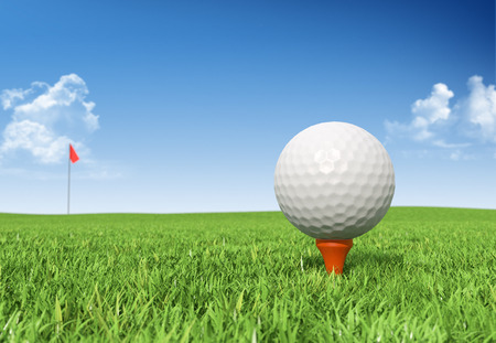 golf ball: Golf ball on tee in grass