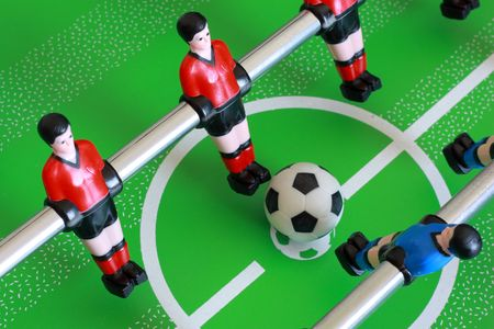 foosball: Kick off on a foosball table Stock Photo