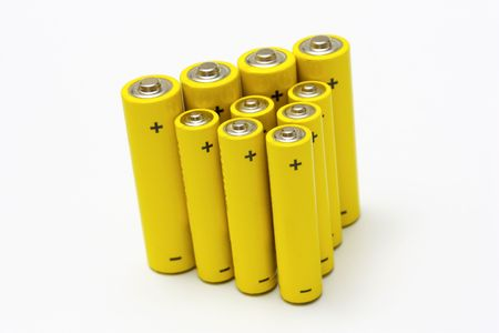 nimh: group of yellow anonymous alkaline batteries isolated on white background Stock Photo