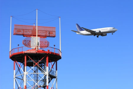 control tower: radar airport with jet airplane on background