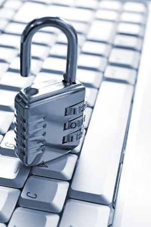 mobile security: padlock on computer keyboard Stock Photo