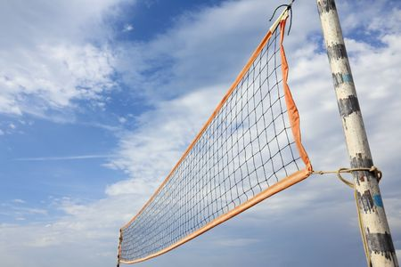 A beach volleyball net in sunny day over blue cloudy sky Stock Photo - 7641170