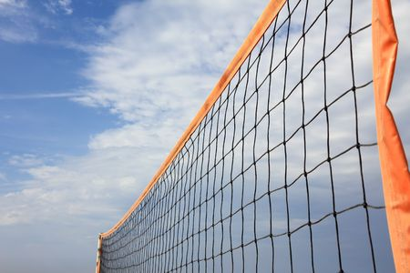 orange beach volleyball net in sunny photo