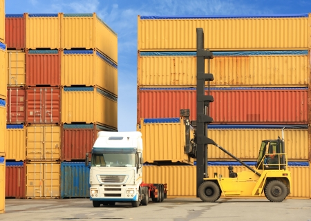 forklift loading containers on white truck in horbor photo