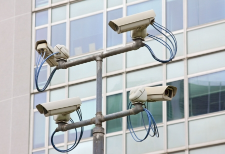 Surveillance security video camera in urban setting Stock Photo - 8042013