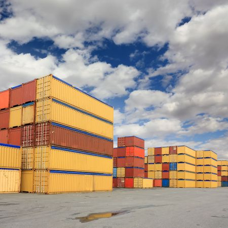 Containers waiting to be loaded in international harbor photo