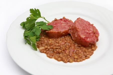 large boiled pork sausage, italian cotechino, with lentils  photo