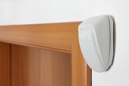 alarm system: burglar alarm movement sensor on white wall