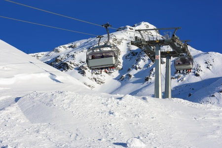 chair lift over slope in alps, Italy Stock Photo - 8556170