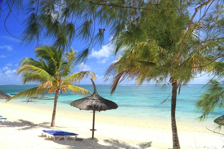 chairs and umbrella on tropical beach  photo