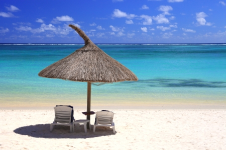 chairs and umbrella on tropical beach Stock Photo - 8800315