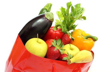 red shopping bag full of groceries isolated on white background Stock Photo - 9044012
