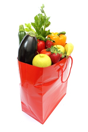 red shopping bag full of groceries isolated on white background Stock Photo - 9044011