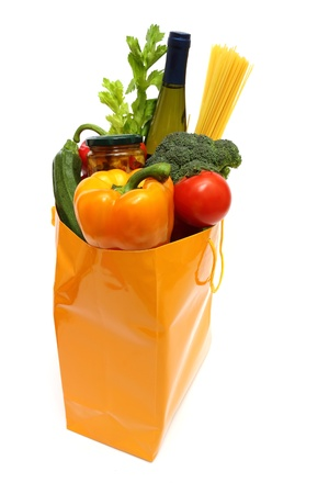 yellow shopping bag full of groceries isolated on white background Stock Photo - 9044009