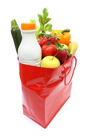 red shopping bag full of groceries isolated on white background photo