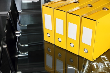 row of yellow documents folders on desk in office photo