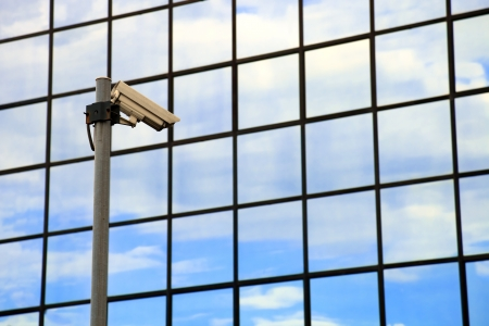 monitoring system: security camera on front of glass building