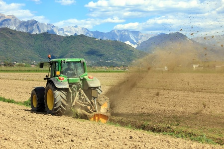 agricultural machinery: agriculture, tractor working on a field