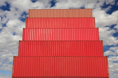 red stacked containers waiting to be loaded in harbor photo