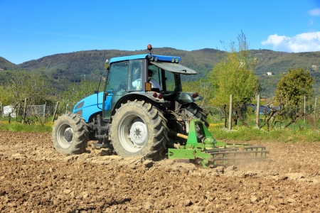 tractor farming in rural field photo