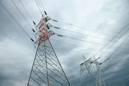 pylon: electric high voltage pylon against dramatic sky