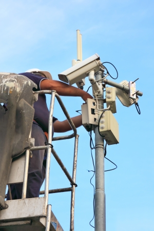 city surveillance: service on a security camera installation Stock Photo