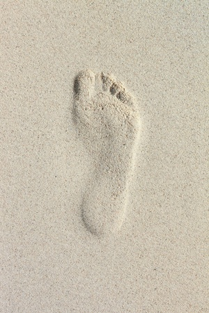 single footprint on beach sand photo