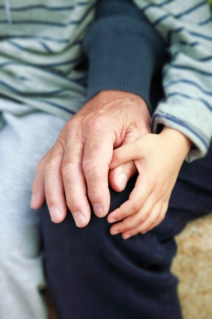 grandson: grandfather and grandson holding hands Stock Photo