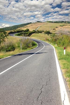 long winding road trough tuscany hills photo