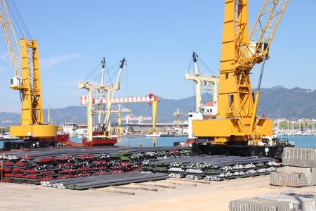 Large industrial harbor crane loading a ship photo