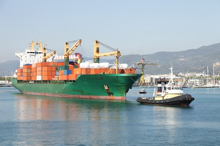 tug boat: tug boat towing container ship in harbor