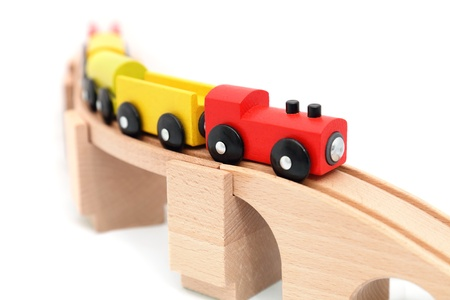 Wooden train toy isolated on white photo
