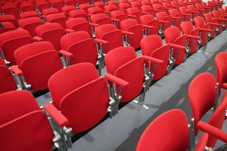 red chair seats in an empty conference room photo