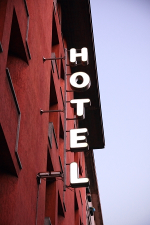 hotel sign: Light hotel sign at duskin in city  Stock Photo