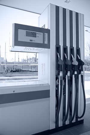 liter: gas pump nozzles on a petrol station Editorial