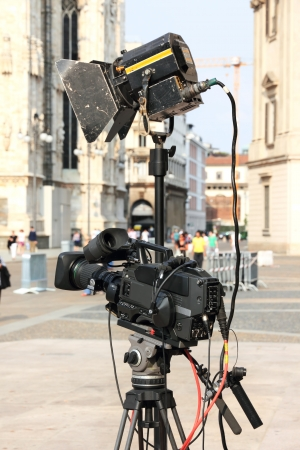 Modern video camera on a tripod in an outdoor news set Stock Photo - 13926638