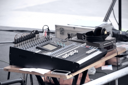 mixer and headphones in music studio or stage photo