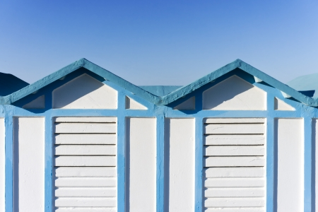 blue and white wooden beach hut in Rimini, Italy photo